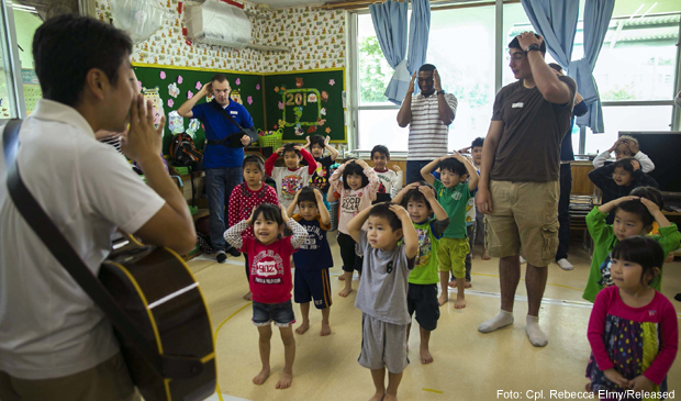 "Marines with 3rd Intelligence Battalion dance and sing to ""Head, Shoulders, Knees and Toes"" during the Play in English Program March 18 at Suginoko Preschool in Kin Town, Okinawa. The Marines visit the preschool monthly to teach English as well as get to know their neighbors. The children learned how to say the Marines names and how they feel. The day ended with free time to play with the volunteers. The Marines are with 3rd Intel Battalion, III Marine Expeditionary Force Headquarters Group, III MEF. (U.S. Marine Corps photo by Cpl. Rebecca Elmy/Released)"